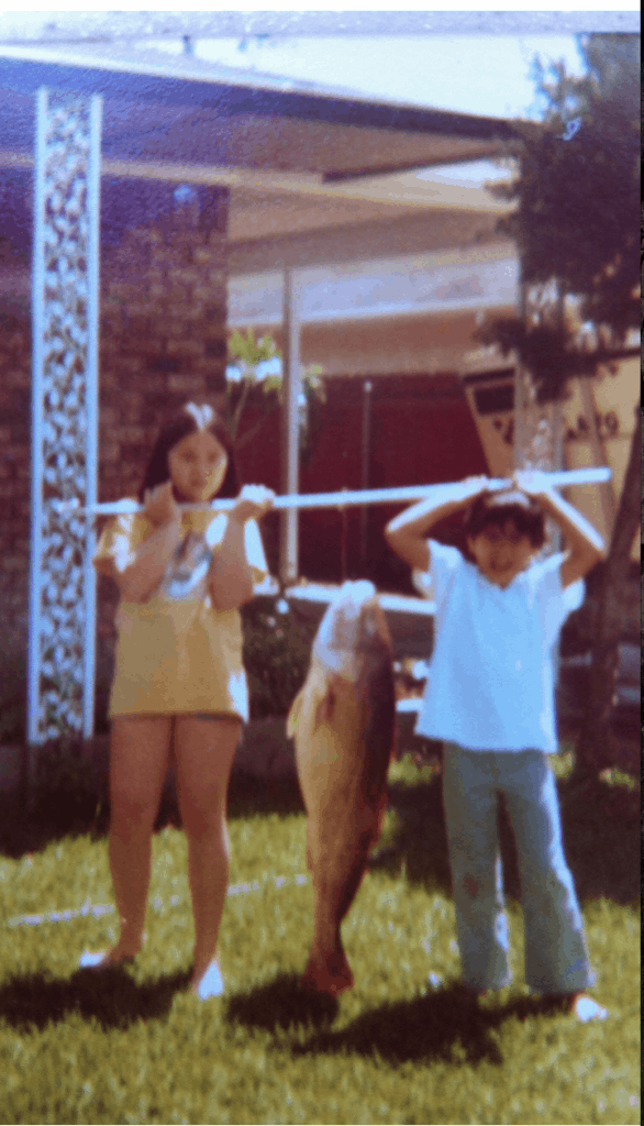 Me and my little bro' circa 1977 with a giant redfish I'd hooked earlier.